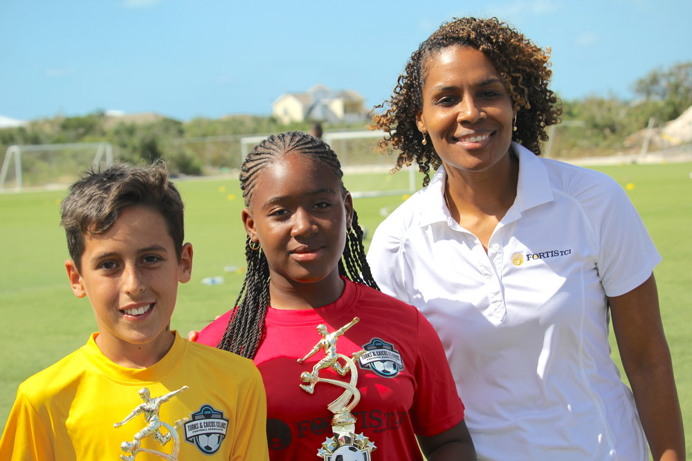 Fortis TCI's Talisha Simons with the winners of the penalty power-kick, Louis McCabe and Jodee Harvey
