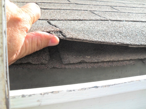 2 layers of shingles on existing roof.JPG
