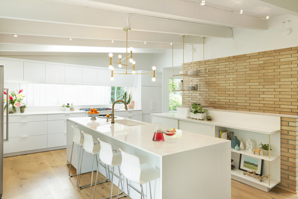 Brass advances while chrome recedes in this midcentury kitchen /  Vela Creative