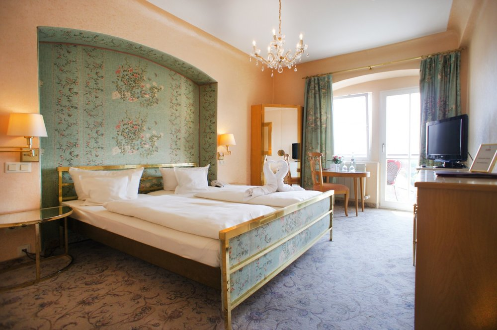 A historic room at  Hotel Eisenhut  showcases a classic color palette.