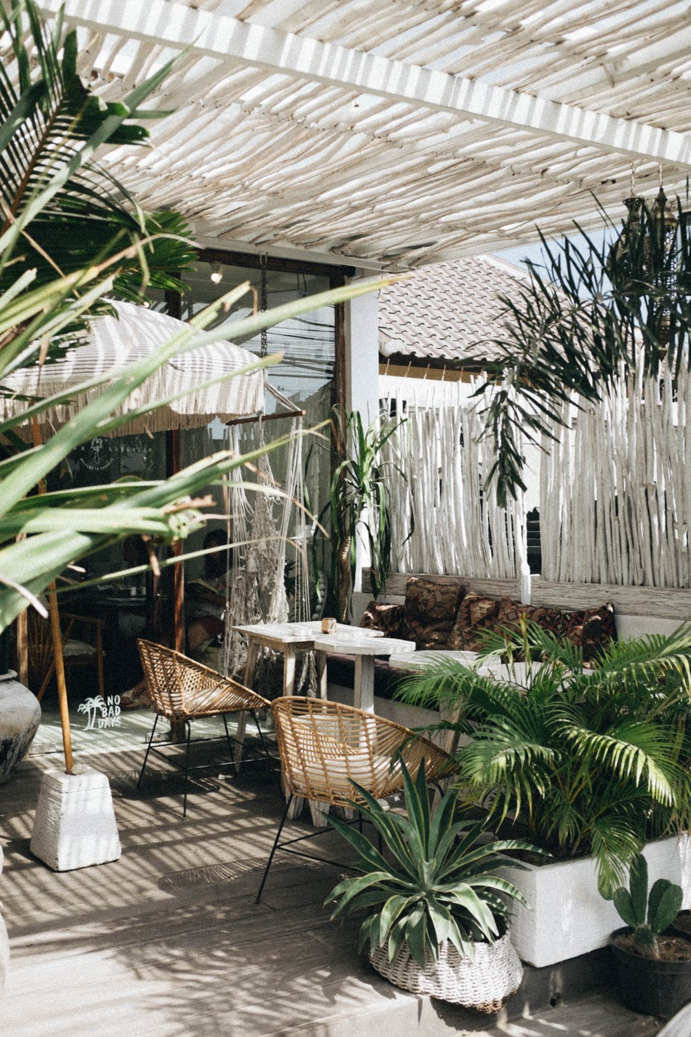 This patio in Indonesia sits underneath a wooden pergola, which provides varying pockets of shade as the sun makes its way across the sky. / Image by    Sonnie Hiles via Unsplash
