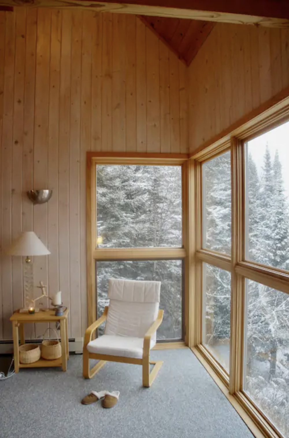 A cozy corner allows for pure relaxation as the snow gently falls among the surrounding trees. /  Source