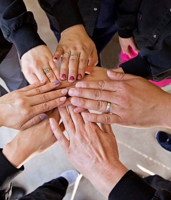 team-hands.jpg