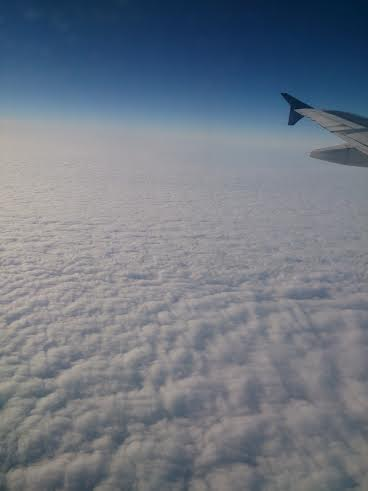 wing over clouds.jpg