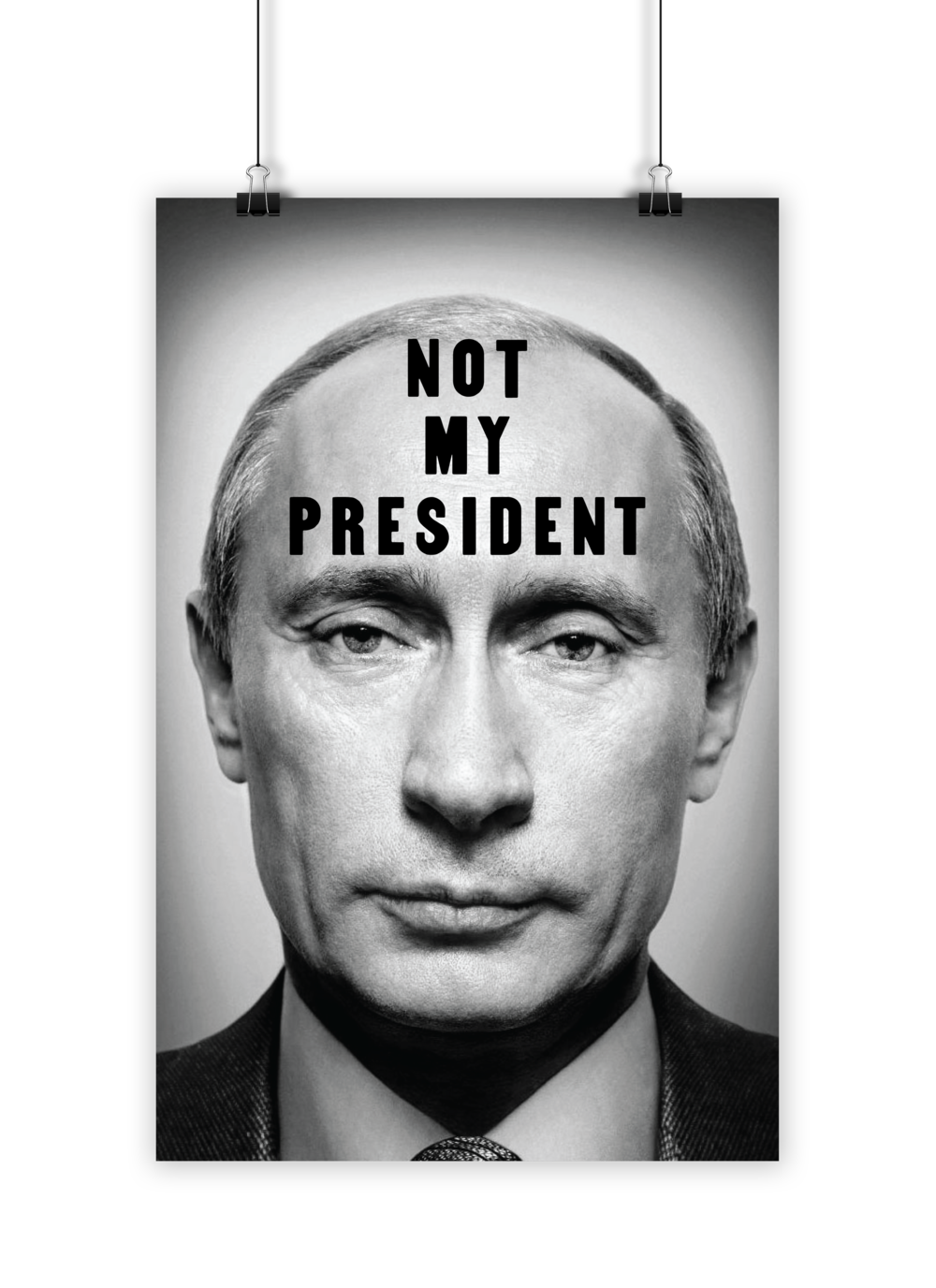 "Protest sign designed for an anti-Trump rally, shortly after inauguration. Poster shows Putin's face, with the title ""Not My President."""