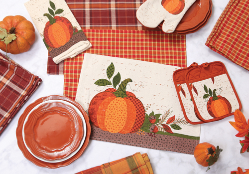 Select Plaid and Pumpkin Placemats, Potholders, & Dishtowels - 1.97 (3.99 value) - at Prairie Gardens in Champaign, IL