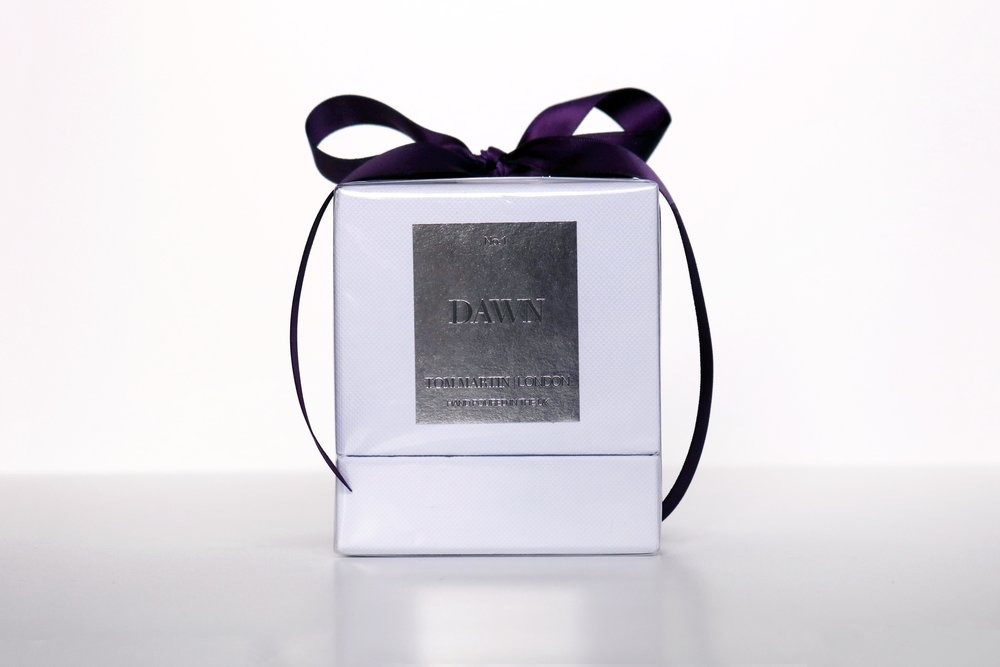 - Each candle arrives packaged in our signature white gift boxes with silver foil detailing, each hand tied with our signature purple ribbon.