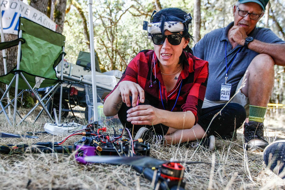 Angela Jacques of FPV Racing Mexico repairs an X Class Drone after crashing it during a practice race at the West Coast Throwdown - Mike Henneke/The News Review