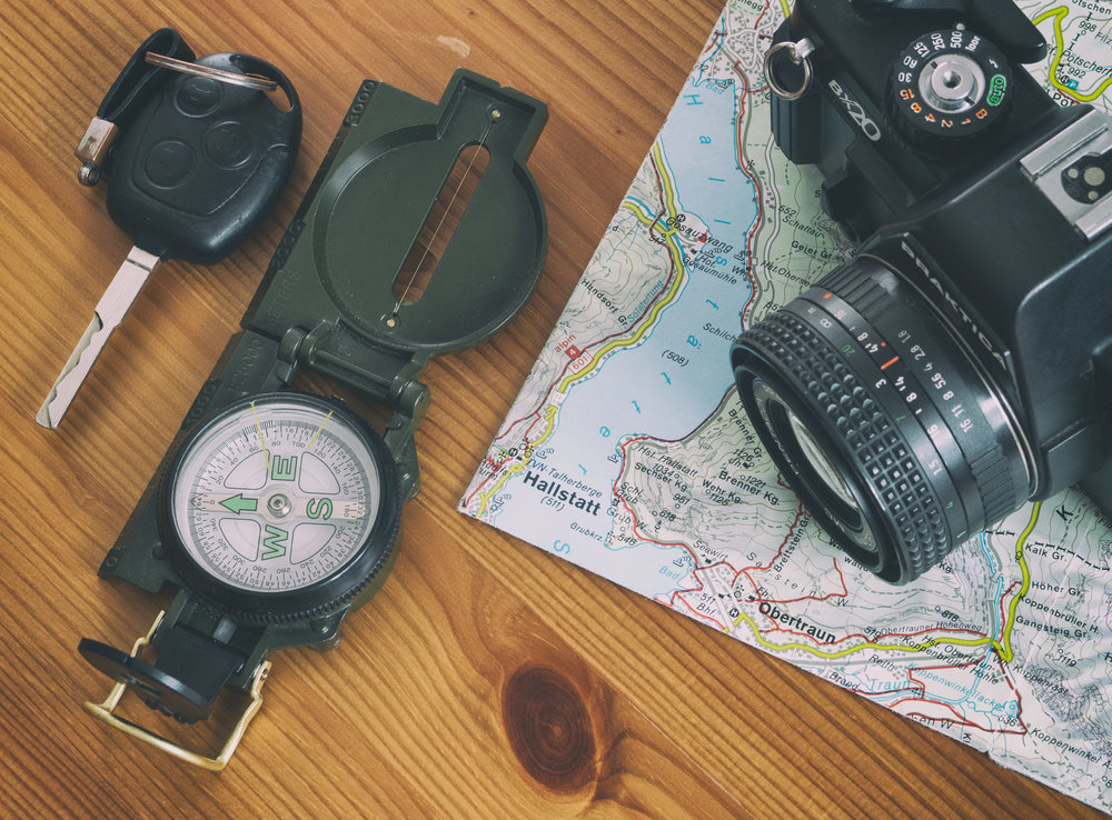 travel-map-car-key-compass-and-camera.jpg