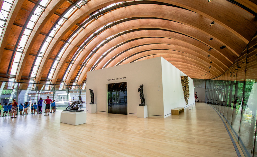 A scene from a fairy-tale, the architecture of Crystal Bridges is a work of art on it's own. Multiple wood-and-glass pavilion bridges like the one above span across a two creek-fed ponds.