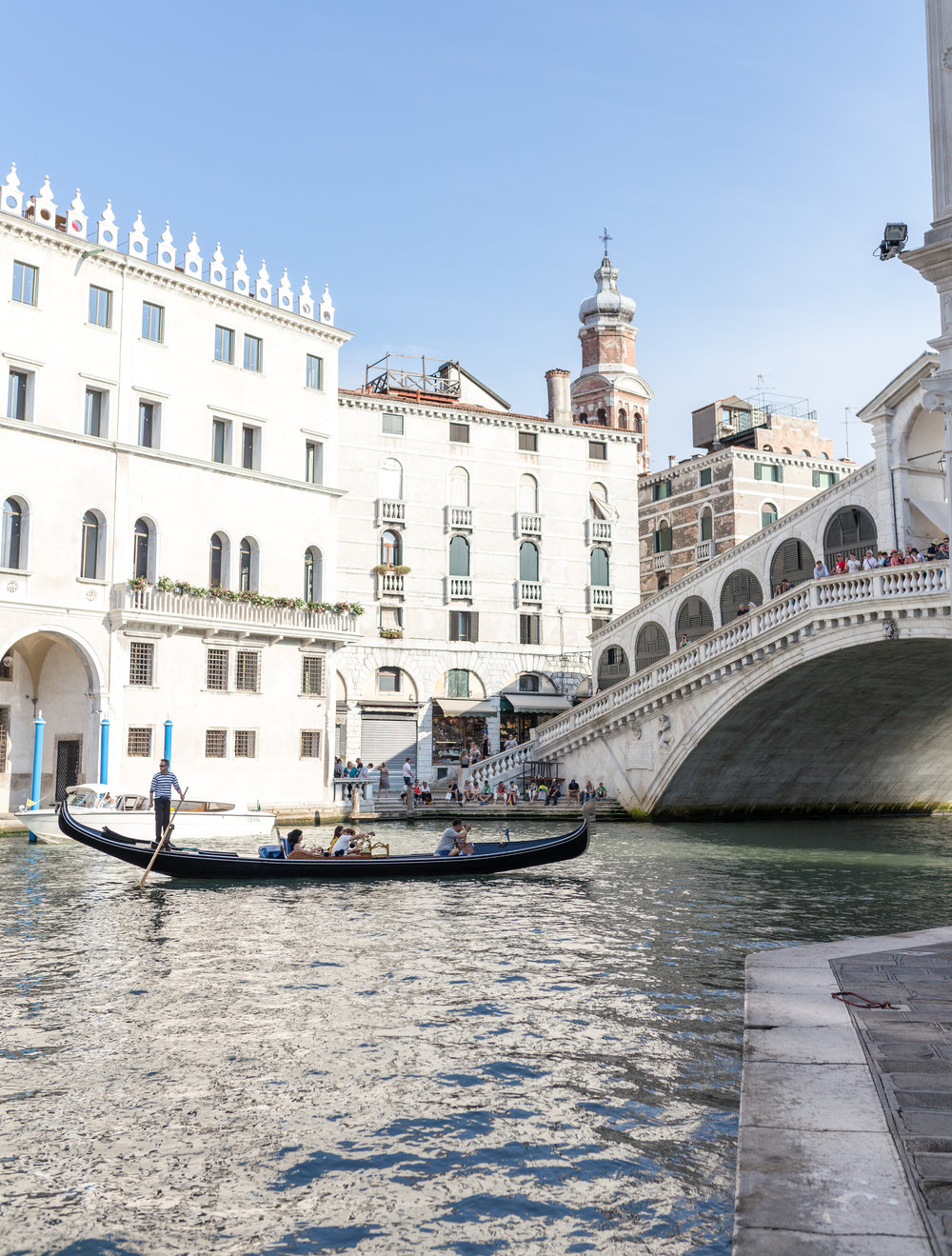 The Rialto Bridge, taken from a sidewalk on the Grand Canal