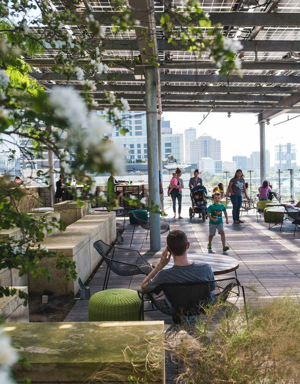 The rooftop patio has fantastic views of the surrounding skyline, and a nature oriented-feel.