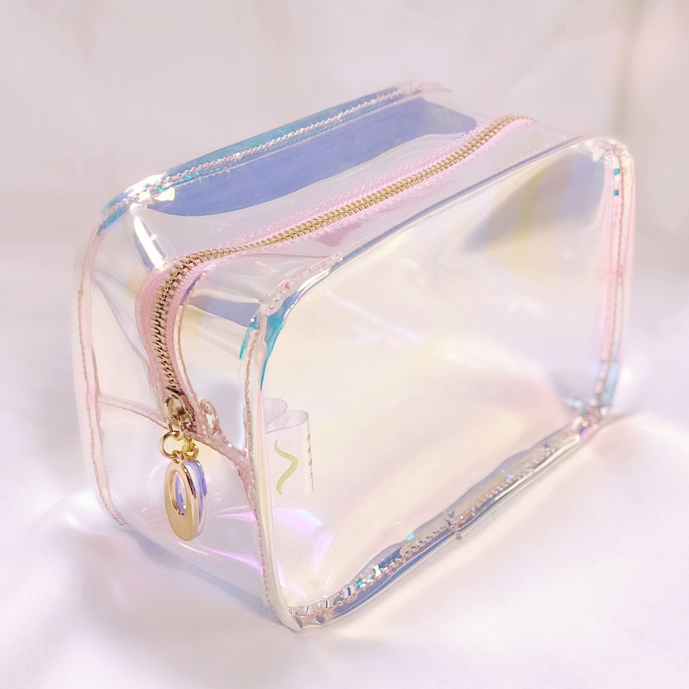 Vere Prism Collection - Made with the same antimicrobial, eco-conscious material as our Everlasting Hairband, the Prism Collection features cosmetic cases & handbags in a translucent, iridescent shade, and merges style, durability, and health- consciousness.