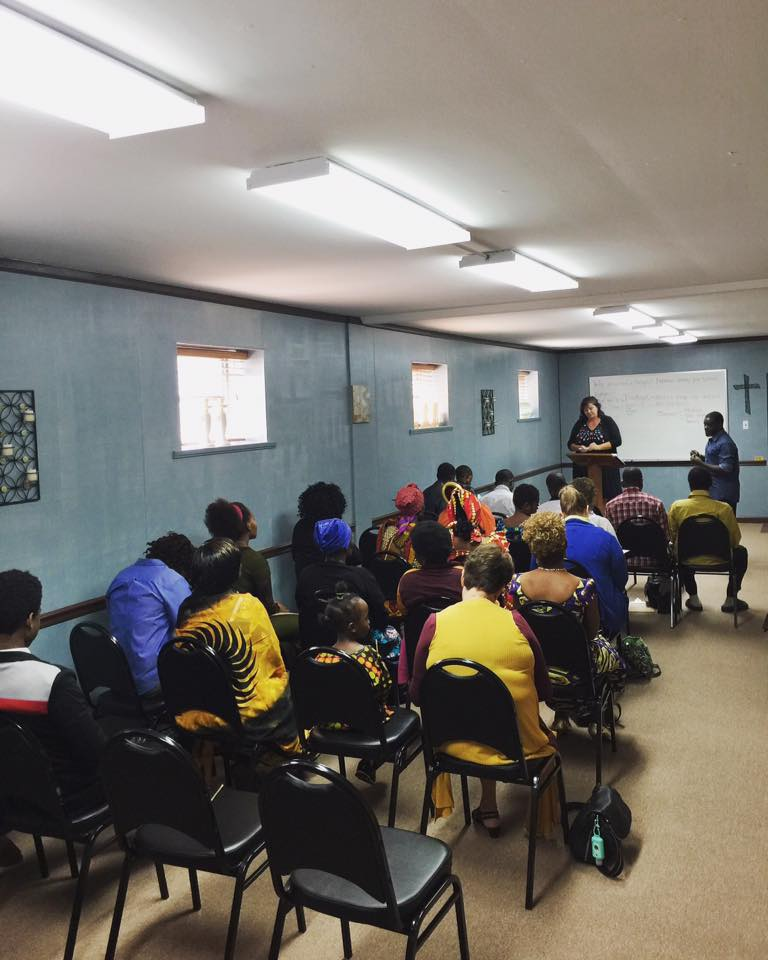 african refugees learning how to budget in a life skills class. -