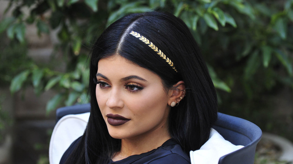 - Los Angeles, CA - 10/19/2015 - Kylie Jenner shows off one of the new scunci hair tattoos while playing with her pups at a shoot. -PICTURED: Kylie Jenner -PHOTO by: Michael Simon/startraksphoto.com -MS_287598 Editorial - Rights Managed Image - Please contact www.startraksphoto.com for licensing fee Startraks Photo Startraks Photo New York, NY  For licensing please call 212-414-9464 or email sales@startraksphoto.com Image may not be published in any way that is or might be deemed defamatory, libelous, pornographic, or obscene. Please consult our sales department for any clarification or question you may have Startraks Photo reserves the right to pursue unauthorized users of this image. If you violate our intellectual property you may be liable for actual damages, loss of income, and profits you derive from the use of this image, and where appropriate, the cost of collection and/or statutory damages.