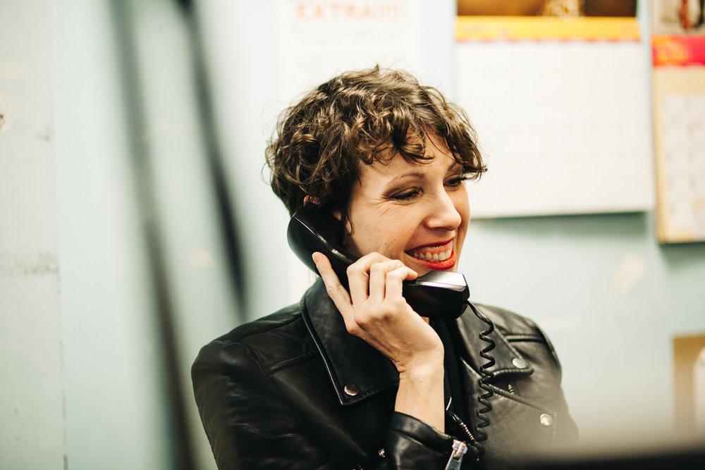 Female Radio DJ on the phone