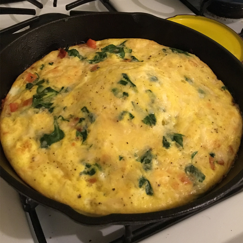 Check out that middle puff! Featured ingredients: spinach, butternut squash. (How to make a frittata)
