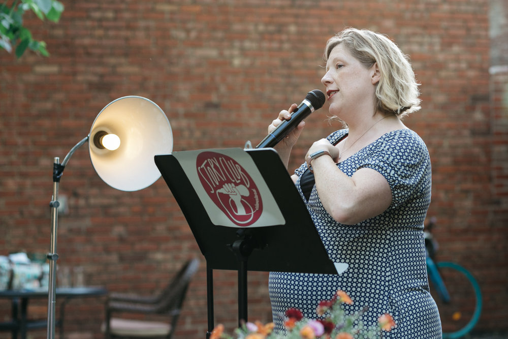 A woman tells a story on stage in Cleveland