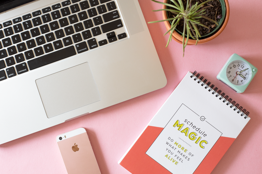 """Laptop, iPhone, and Free Period Press """"Schedule Magic"""" planner"""