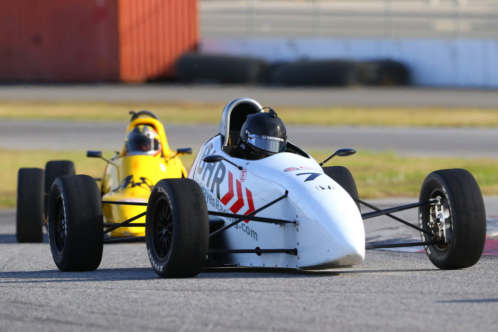 Brad leading Steve Meyer through the turn 13