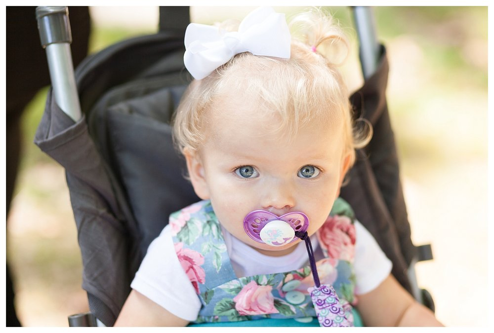 I don't know what it is about little kiddos and pacifiers.  I find it so darn adorable!!