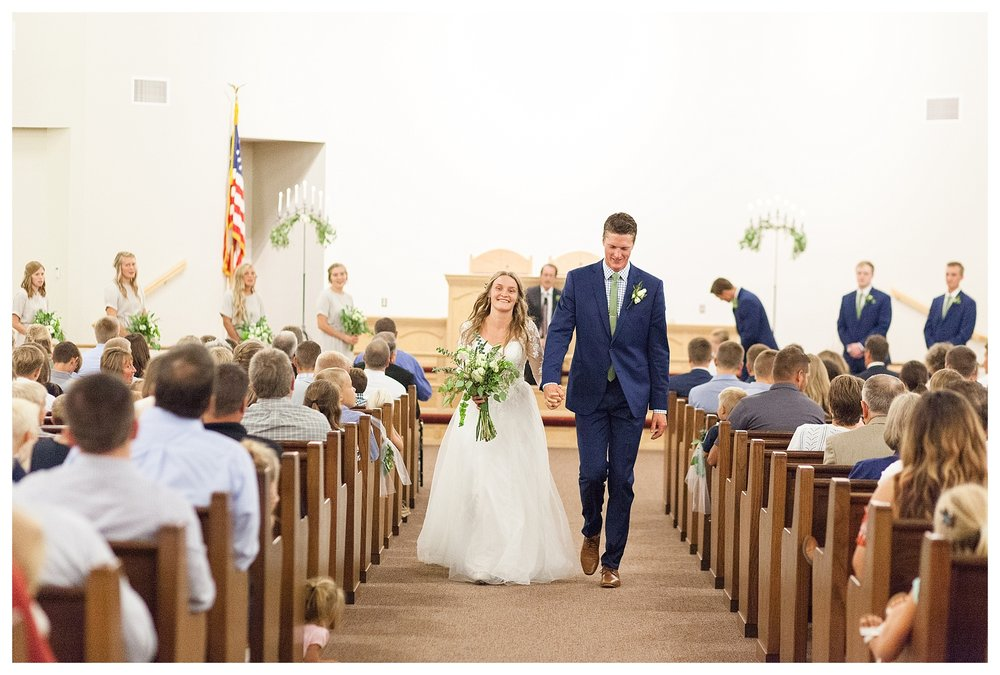 JUST MARRIED!  Kaila's face immediately following their walk down the aisle says it all!