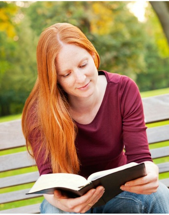 Redhead Christian reading Bible