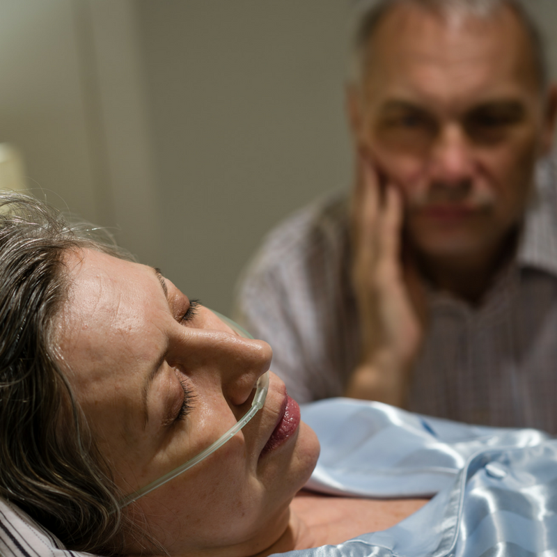 Woman in hospital with man