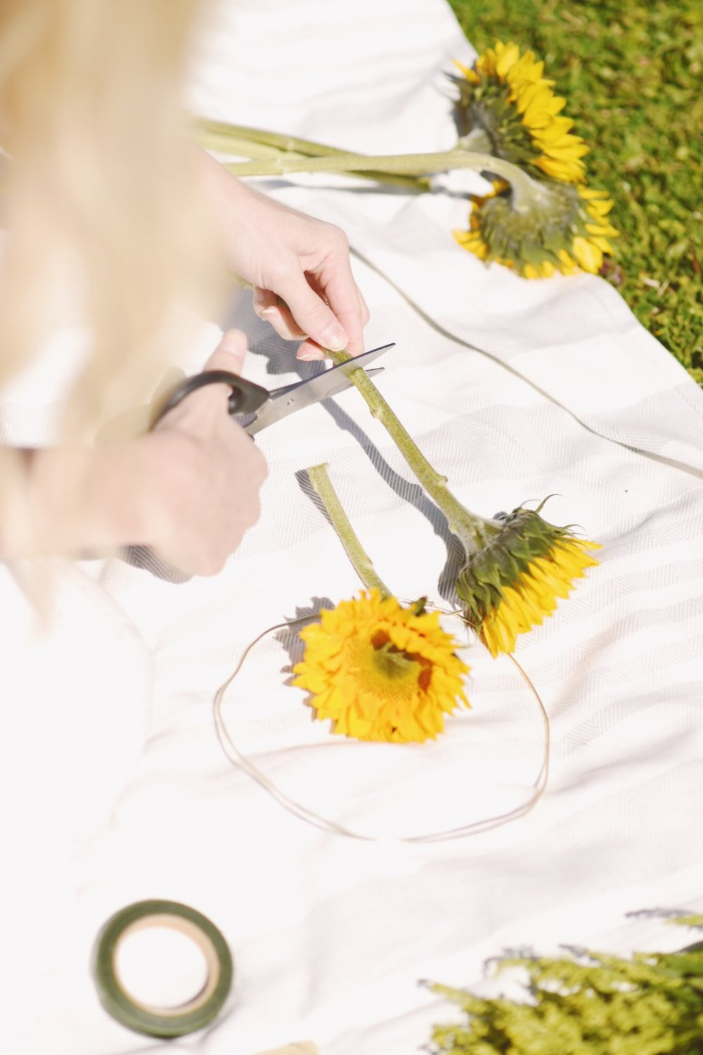 Diy flower crown in my blonde style now you can start adding your flowers onto the heavy wire with your thin green floral wire go in the same direction with the flowers until youve wrapped izmirmasajfo