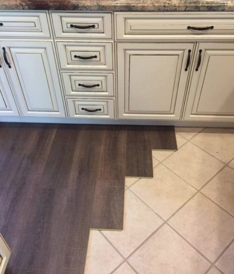 Our first COREtec install...goes right over the existing tile!  - Color: Margate Oak, 9