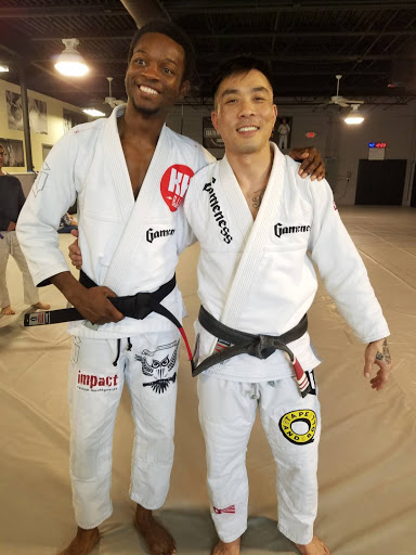 Newest Black Belt Brien Calloway and Prof. Kenny