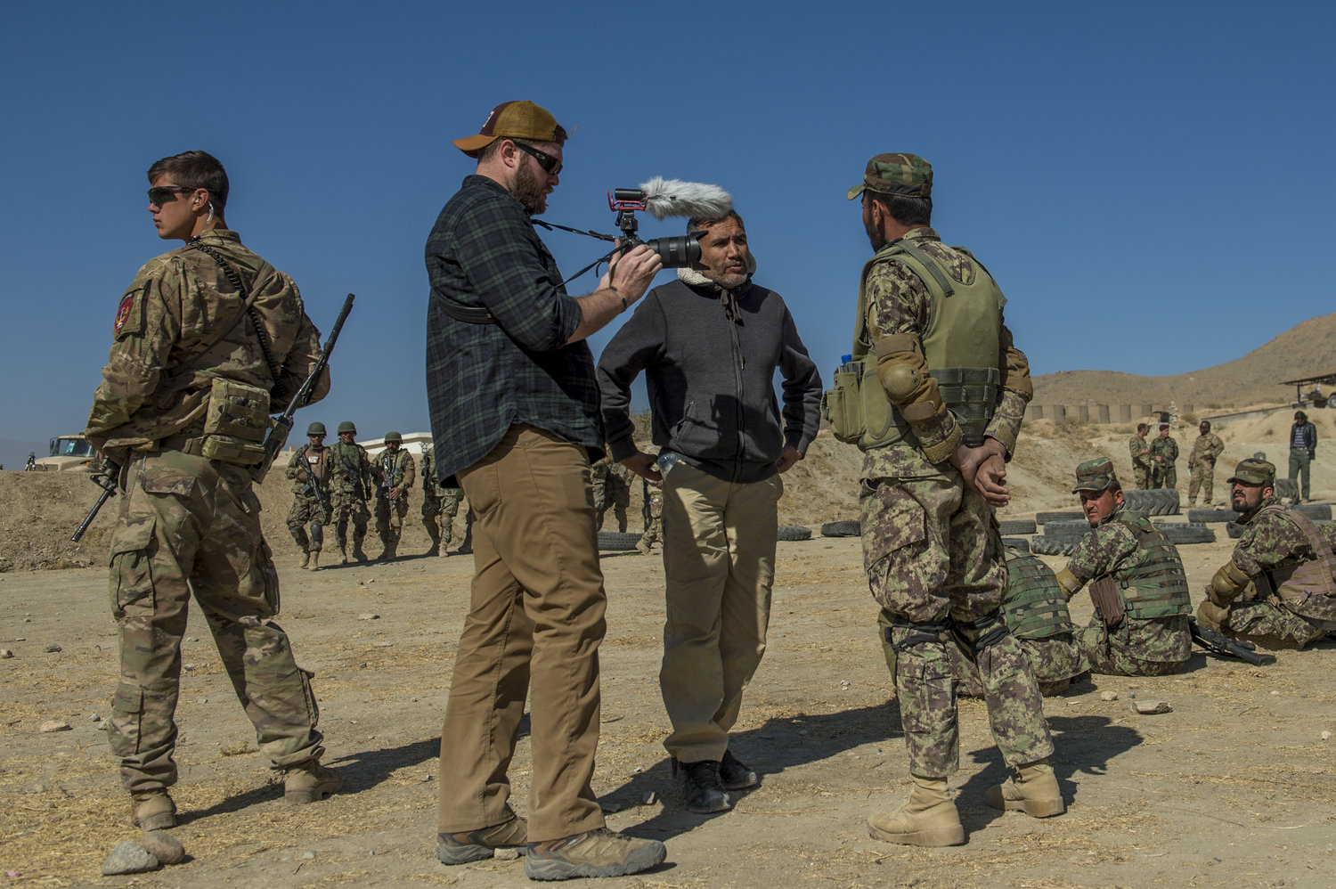 Interviewing the subject of one of my articles at Camp Commando just outside of Kabul. Off to the left of me was a U.S. soldier, known as a 'guardian angel', which was my primary means of protection while embedded.