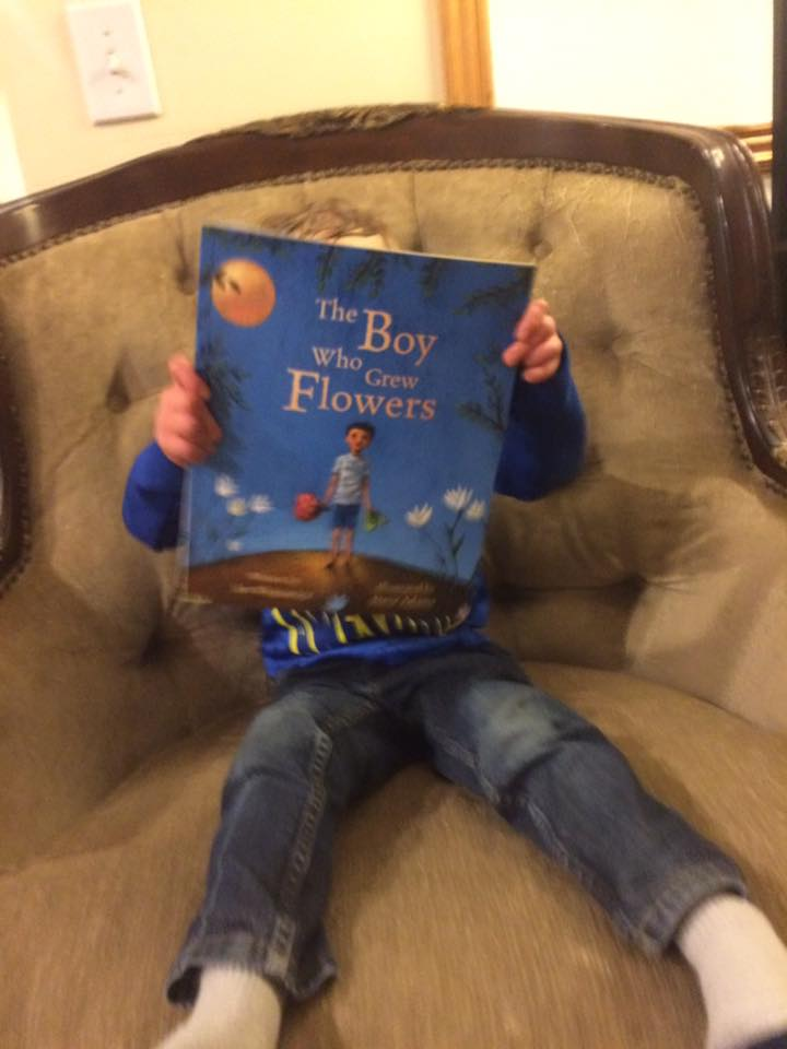 "Atticus reading ""The Boy Who Grew Flowers"". My heart."