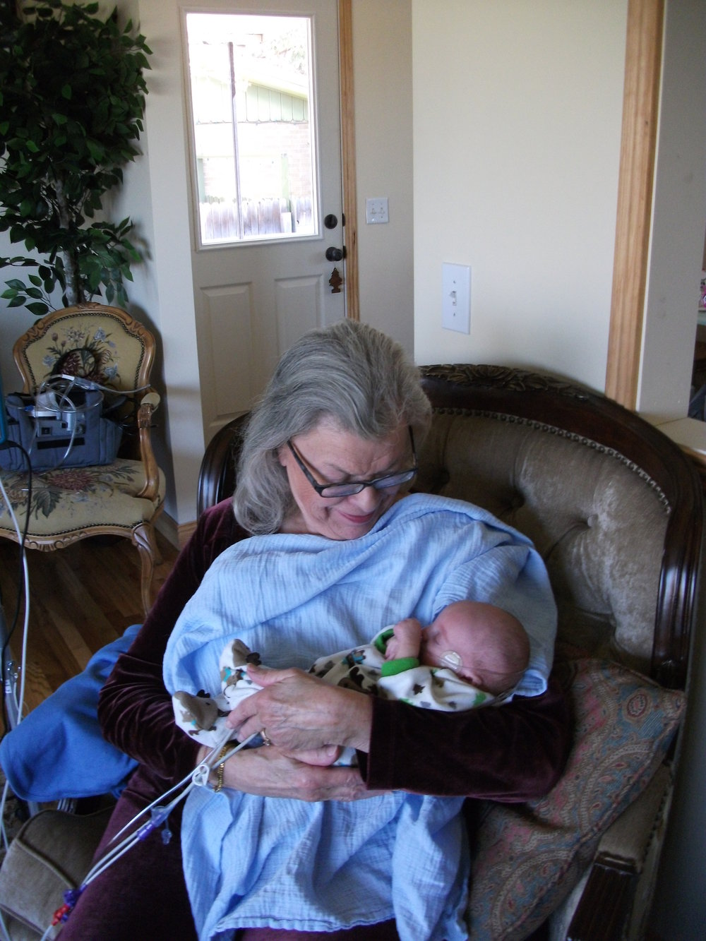 "My grandmother would come over to help. Atticus was only happy when he was being held, and he usually needed his binky held in his mouth as well. (He had a cleft palate and couldn't form suction.) My grandmother was great at ""binky duty""."
