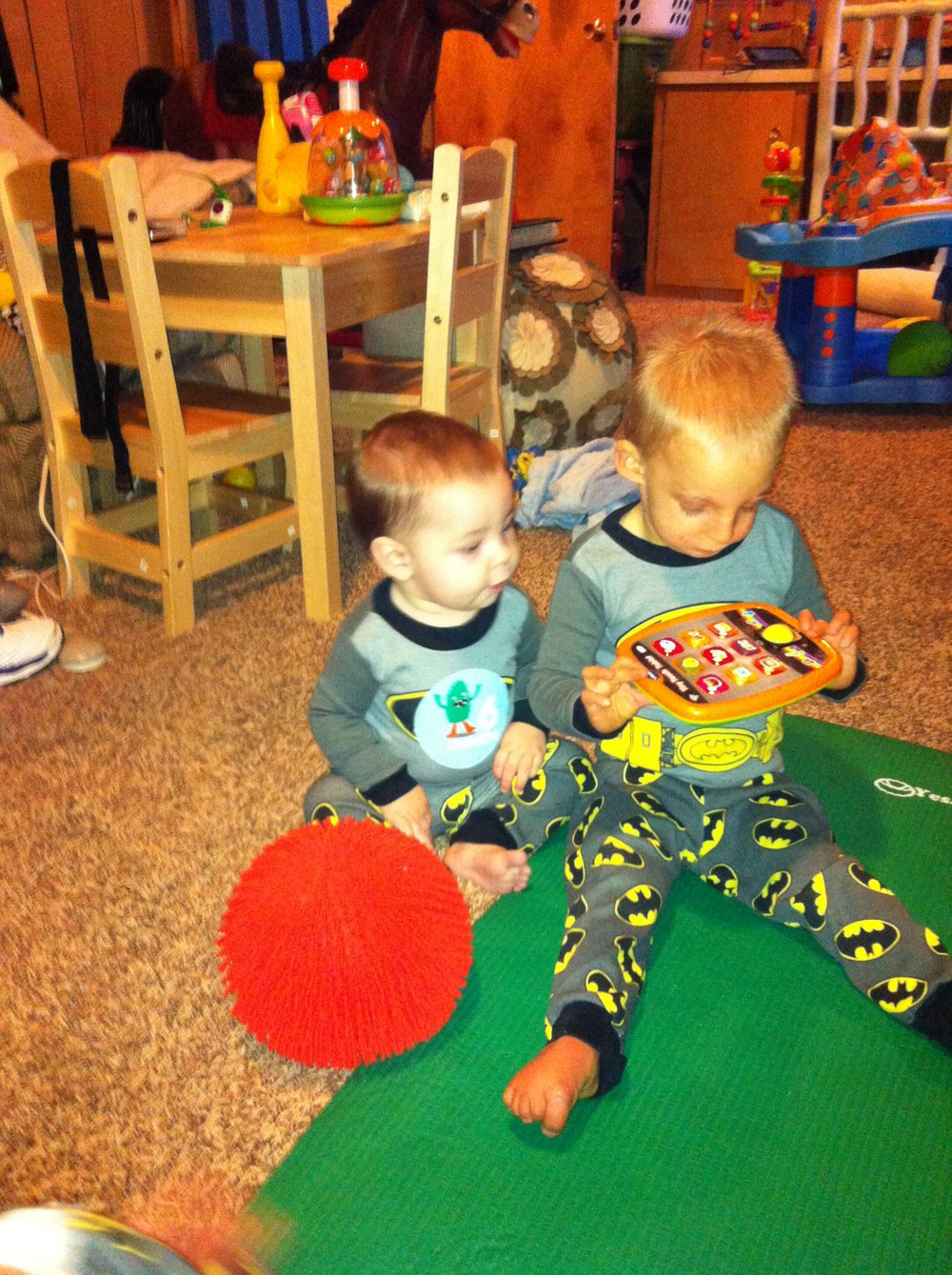 Everett is about to steal that toy. Learning to grab bag was one of Atticus's IFSP goals. ;)