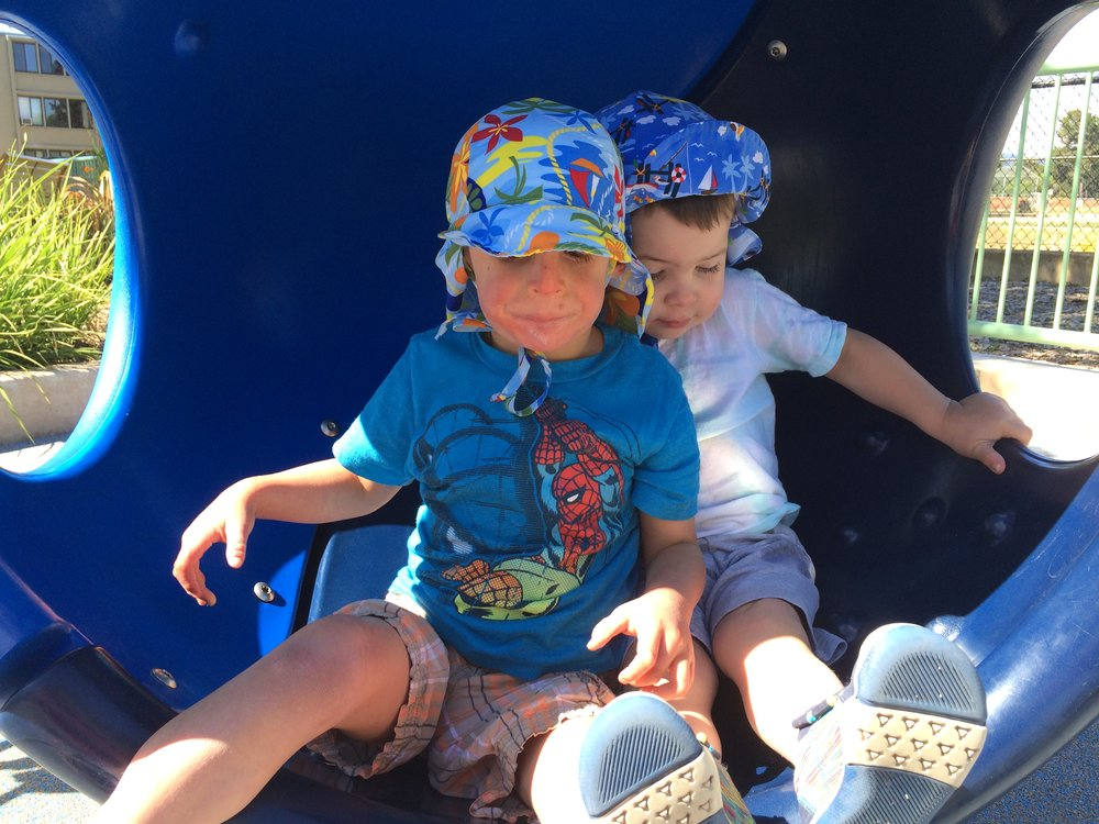 Atticus and Everett at the all-abilities playground.
