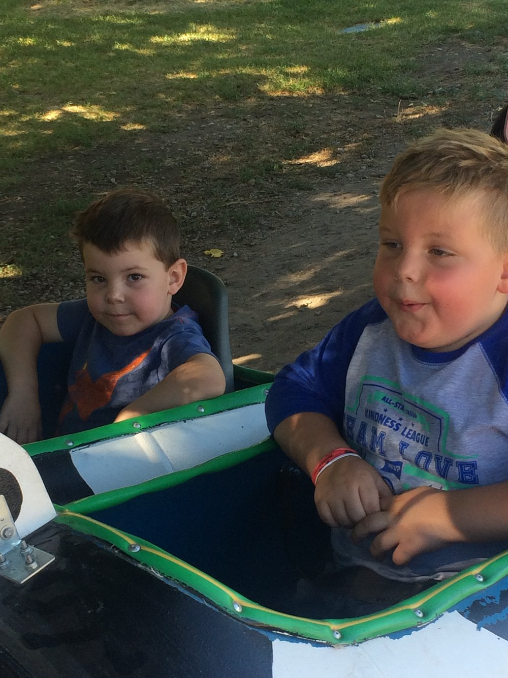 At Wheeler Farm, on Eclipse Day. The last time they rode this ride, Atticus rode it with them. Damien remembered that. Everett probably did not, but said he did. They rode it, and the memory of Atticus rode along. That is just our life now.