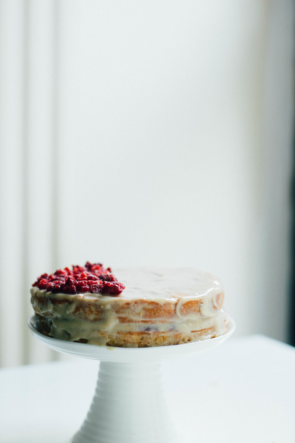 nutmeg and pear | gluten + grain free almond d meal layer cake w/vanilla bean, refined sugar free raspberry preserves + whipped ricotta frosting