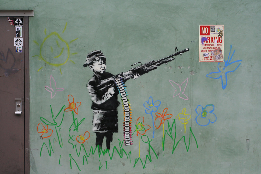 Crayola Shooter by Banksy, 2011; photo by karri mclean alrich, via CC BY-SA 2.0.