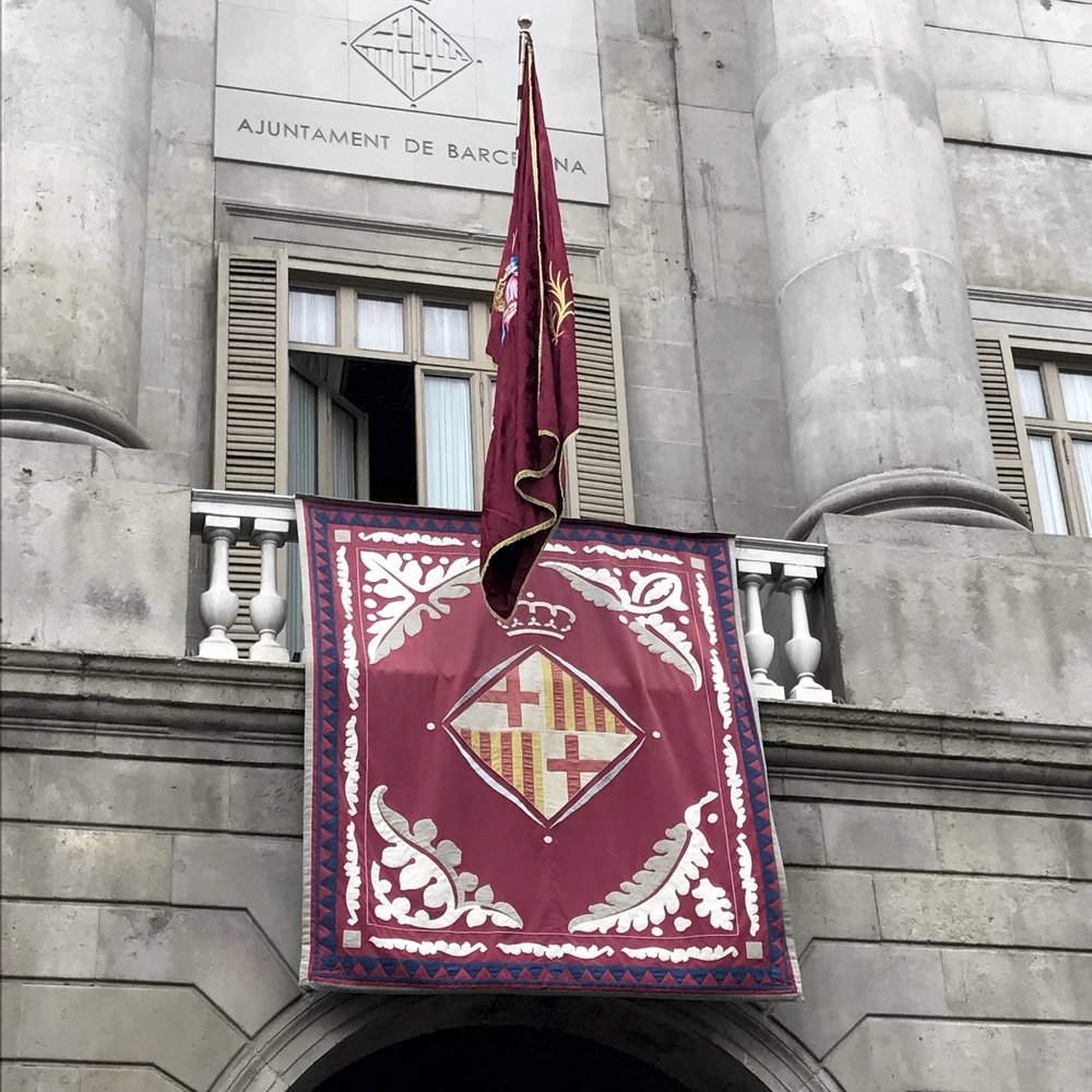 The historical flag of Catalan on display in the town square.