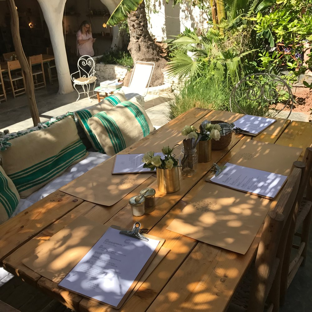 Our table in the shade felt like a peaceful oasis compared to the little street we entered from