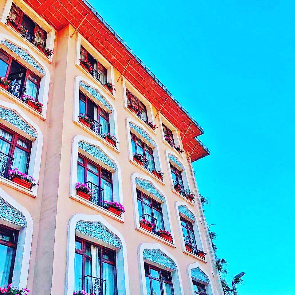 Colorful buildings with tile details and moorish influences