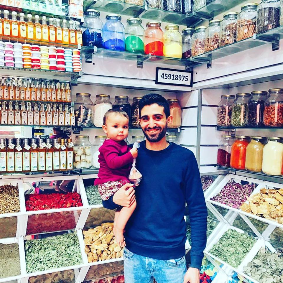 Aria with the shopkeeper at one of our favorite spice shops