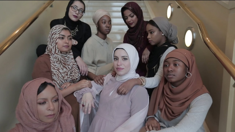 "Mona Haydar (centre) in the ""Hijabi (Wrap My Hijab)"" music video."