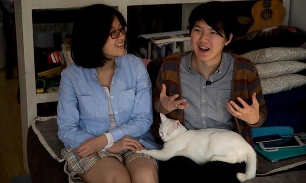 Zheng Churan (left)and Li Tingting. Photograph: Ng Han Guan/AP via  The Guardian