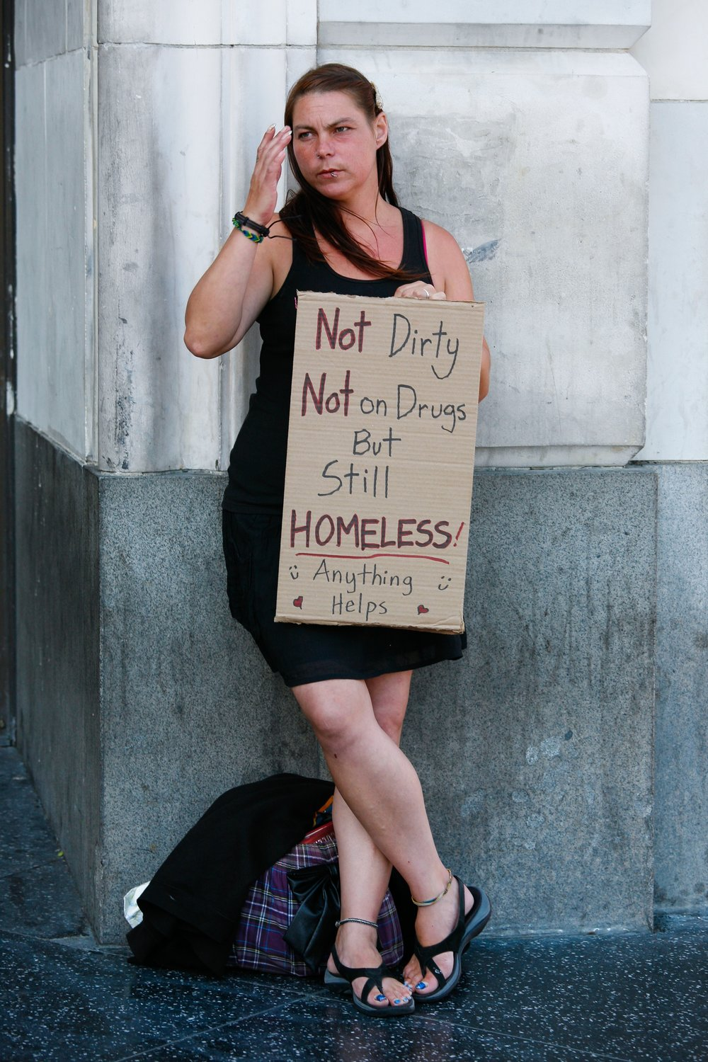 Homeless_female_holding_up_sign_(7617876912).jpg