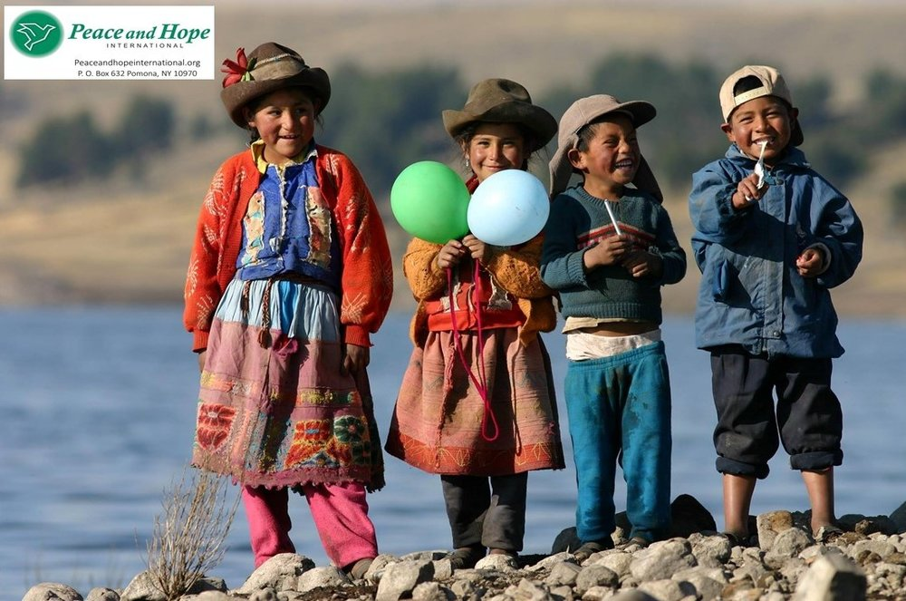 A group of Peace and Hope's young Quechua beneficiaries celebrate together in Andahuaylas, Peru.  Photo Credit: Peace and Hope International