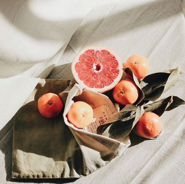 DAM DAM - AMMA collaborated with DAM DAM to produce a range of pomegranate dyed pouches to contain their organic travel sized cosmetics.