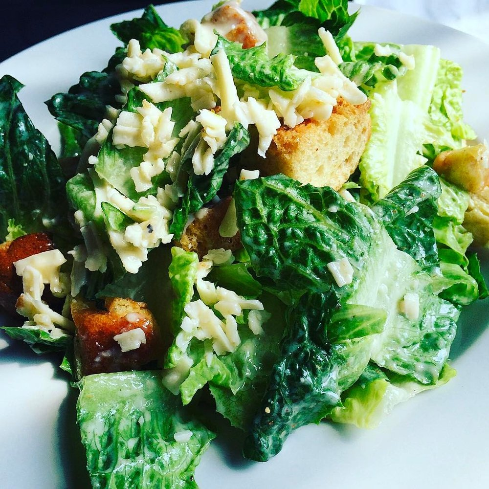 Caesar Salad - Salads can be good. Actually, salads can be great, especially when we're taking about the Burger Mondays Caesar Salad. The romaine lettuce is perfectly tossed with shaved Asiago cheese, toasted croutons and house-made creamy Caesar dressing. We personally like to kick this salad up a notch by adding an Ahi tuna burger to the top of it. Pure salad perfection.