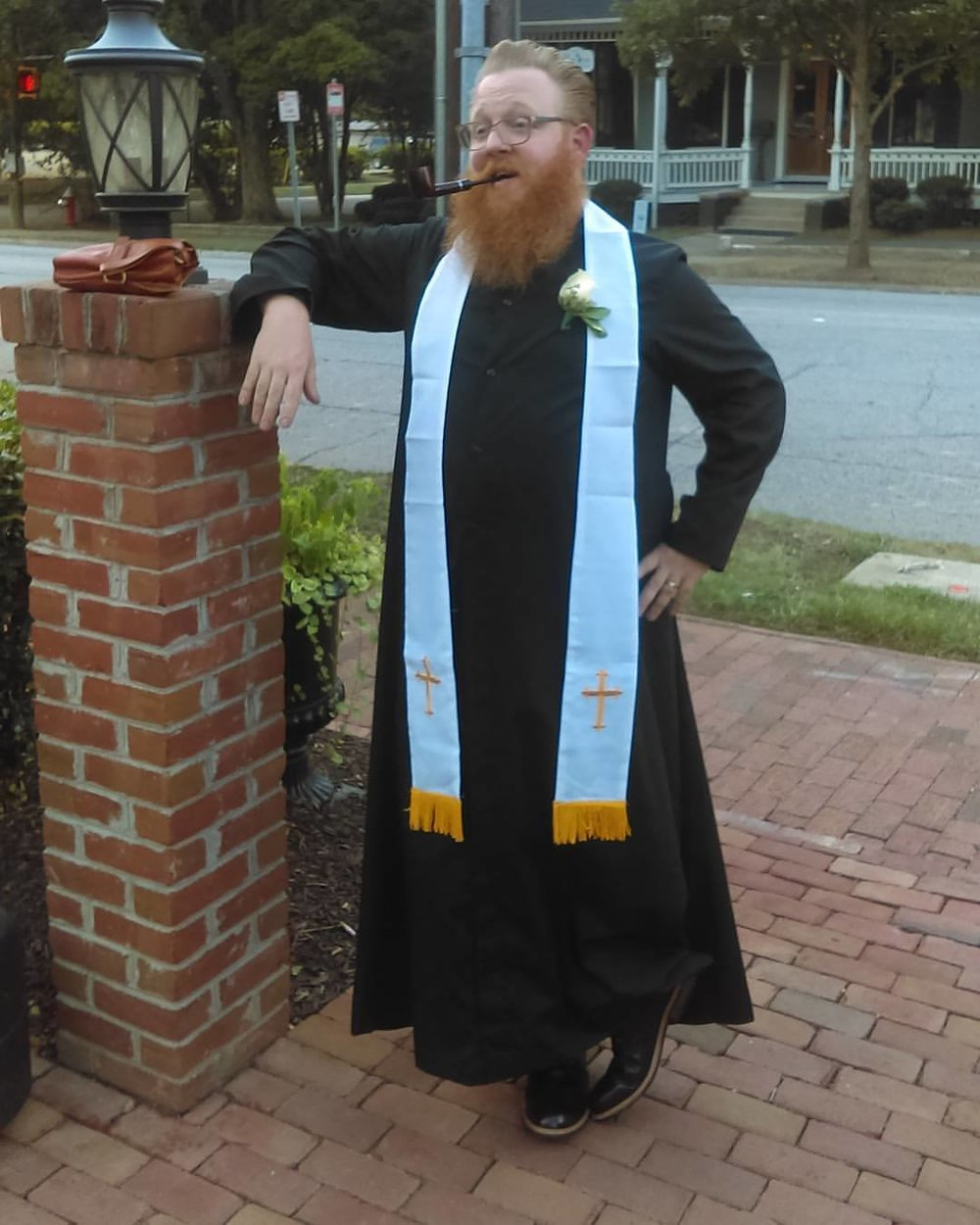 Pipe, cassock, and beard = Legitimate